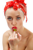 Woman with red strawberry Stock Image