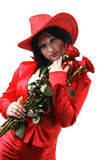Woman in the red suit, hat and red roses Stock Photo