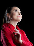 Woman in red suit smile and dream Royalty Free Stock Photo