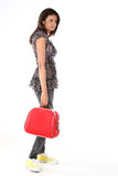 Woman with red suitcase Royalty Free Stock Photos