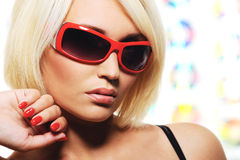 Woman with red sunglasses Stock Images