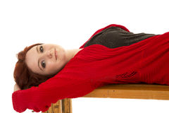 Woman red sweater and hair lay look royalty free stock photo