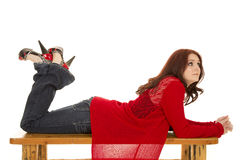 Woman red sweater and hair lay look side stock images