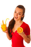 Woman in red t shirt drinking orange juice Stock Image