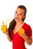 woman in red t shirt drinking orange juice Stock Image