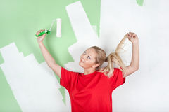 Woman in red t-shirt with paint roller Stock Image
