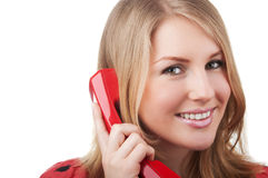 Woman with red telephone Stock Images