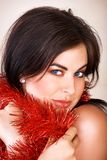 Woman with red tinsel Stock Photo