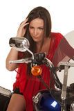 Woman red top motorcycle look mirror Stock Image