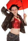 Woman red top and umbrella hair blow Royalty Free Stock Image