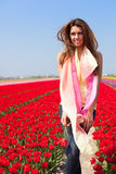 Woman in red tulip field Royalty Free Stock Images