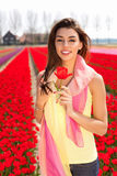 Woman in red tulip field Stock Photography