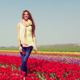 Woman in red tulip field Stock Photo