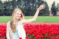 Woman in a red tulip field Stock Photography
