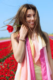 Woman in red tulip field Stock Photos