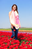 Woman in red tulip field Stock Images