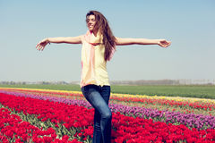 Woman in red tulip field Stock Image