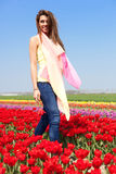 Woman in red tulip field Royalty Free Stock Image