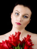 Woman with red tulips Stock Photography