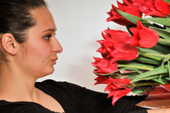 Woman and red tulips Royalty Free Stock Photography