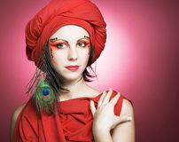 Woman in red turban Royalty Free Stock Images