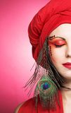 Woman in red turban Royalty Free Stock Image