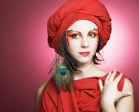 Woman in red turban Stock Images