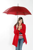 Woman with red umbrella. Smilling woman standing under red umbrella Stock Images