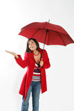 Woman with red umbrella. Smilling woman standing under red umbrella Royalty Free Stock Photography