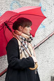 Woman with red umbrella posing Royalty Free Stock Photography
