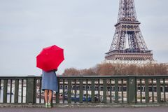 Woman with umbrella looking at Eiffel tower in Paris, travel to France royalty free stock images