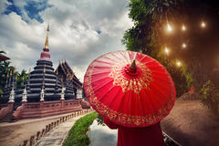 Woman with red umbrella in Thailand Royalty Free Stock Photos