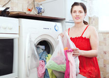 Woman  uses bag for laundry in machine Royalty Free Stock Photos