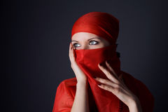 Woman in red veil photo Royalty Free Stock Photos