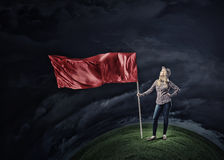 Woman with red waving flag Royalty Free Stock Photo