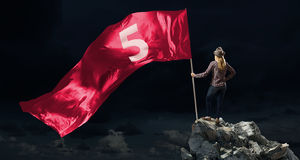 Woman with red waving flag Royalty Free Stock Image