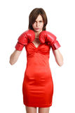 Woman in red, wearing boxing gloves Stock Photography
