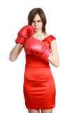Woman in red, wearing boxing gloves Stock Images
