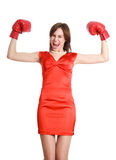 Woman in red, wearing boxing gloves Royalty Free Stock Photos
