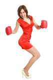 Woman in red, wearing boxing gloves Royalty Free Stock Image