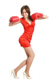 Woman in red, wearing boxing gloves Royalty Free Stock Photography