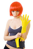 Woman in red wig and yellow gloves. Confident woman cleaner with red hair and yellow gloves Royalty Free Stock Photography