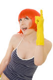 Woman in red wig and yellow gloves Stock Photography