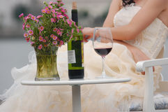Woman with red wine and flowers Royalty Free Stock Photo