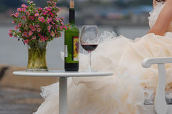 Woman with red wine and flowers Royalty Free Stock Image