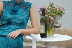 Woman with red wine and flowers Stock Images