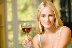 Woman with red-wine glass. Young woman with red-wine glass, indoors stock images