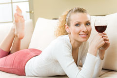 Woman with red wine glass royalty free stock photography