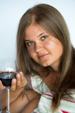Woman with red wine glass. Beautiful young woman drinking red wine isolated on white background Stock Images