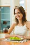 Woman with red wine and salad Stock Images